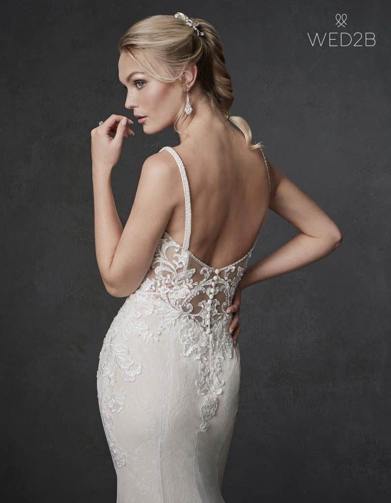 Back crop view of wedding dress with straps Syrah