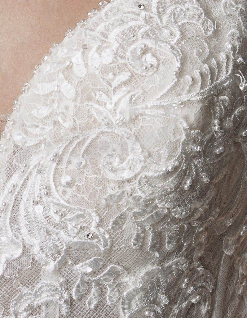 Detail view of wedding dress with straps Syrah