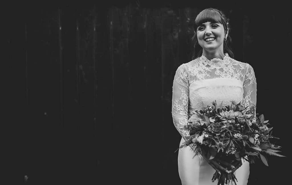 The smiling bride at her mill wedding venue