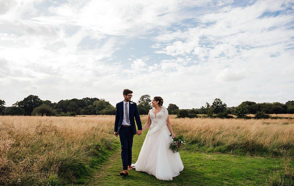 The perfect blush wedding dress for this countryside wedding