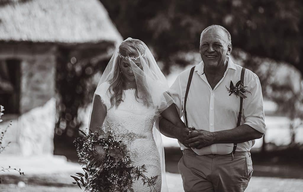 Walking down the aisle at their safari wedding