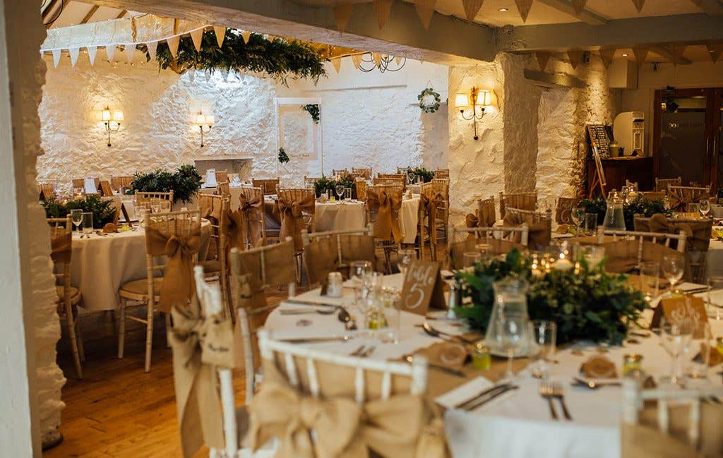A gorgeous mill wedding venue ready for a sit down dinner