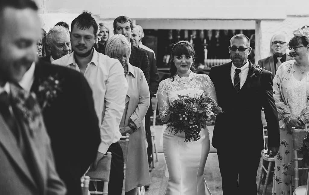 Walking down the aisle at her beautiful mill wedding venue