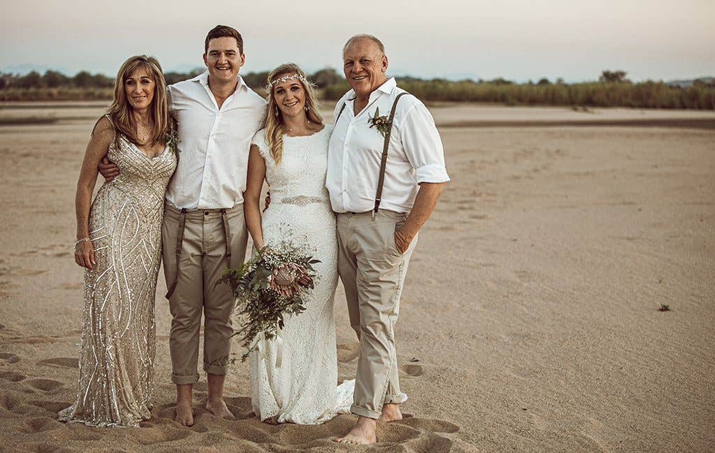 Happy families at their safari wedding