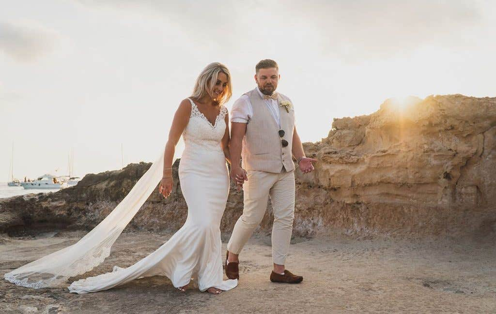 The happy couple on the beach at their Ibiza wedding