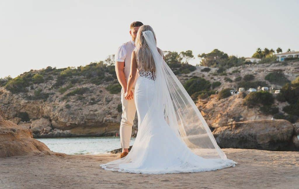 The bride showing off the stunning back detail of Sawyer from The Signature Collection at her Ibiza wedding