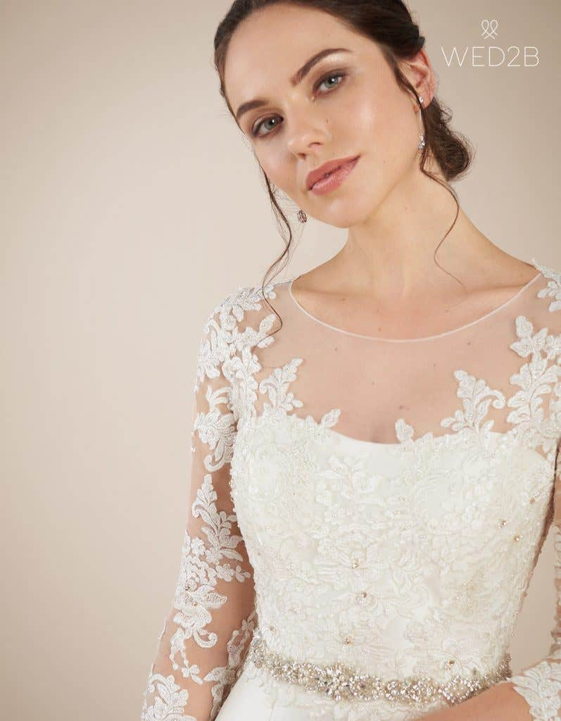 Close-up front view of Dolce, a wedding dress by Anna Sorrano, styled with accessories