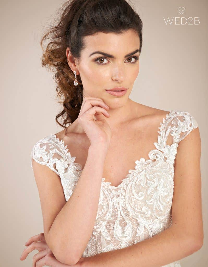 Close-up front view of statement wedding dress Enzo by The Signature Collection