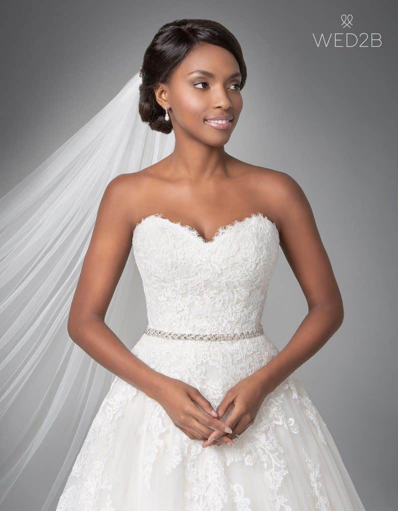 Close-up front view of classic wedding dress Georgette by Anna Sorrano with accessories
