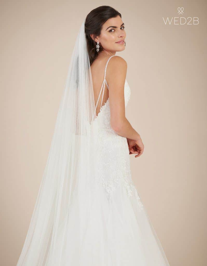 Side view of statement wedding dress Ginger by Viva Bride with accessories