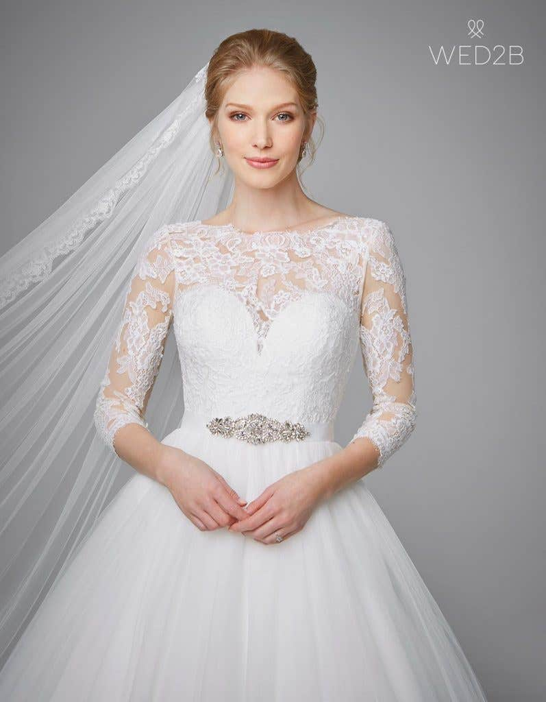Close-up front view of classic wedding dress Kate by Anna Sorrano with accessories