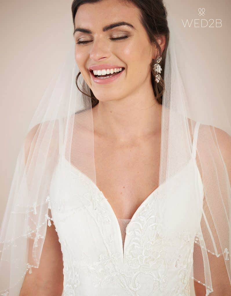 Close-up front view of vintage lace wedding dress Lennox by Viva Bride