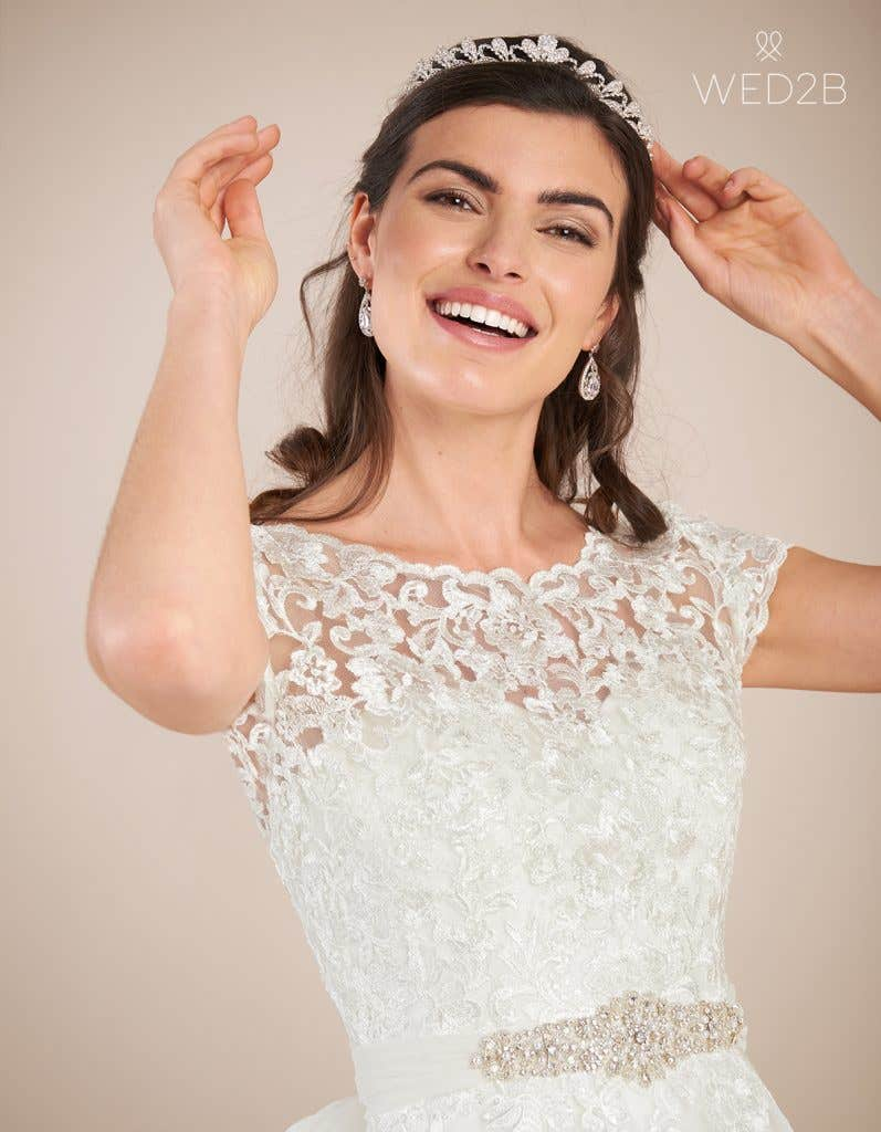 Close-up view of vintage lace wedding dress Madaline by Viva Bride with accessories