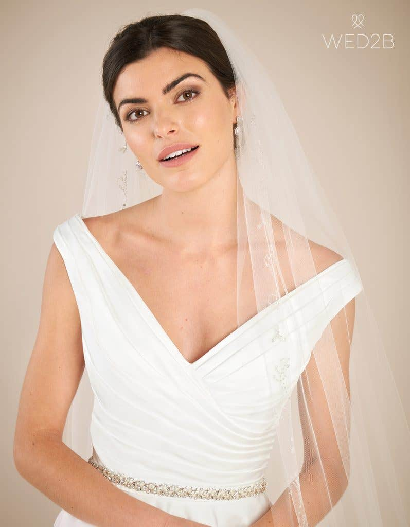 Close-up front view of classic wedding dress Tara by Anna Sorrano with accessories