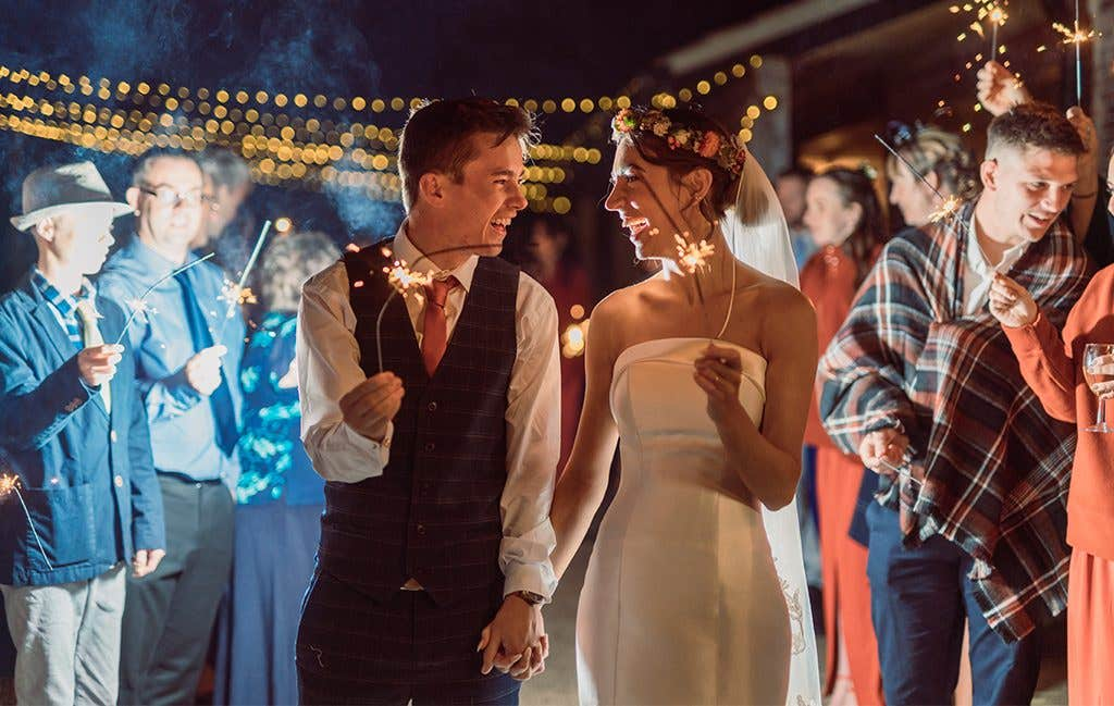 Celebrating with sparklers at this Norfolk wedding