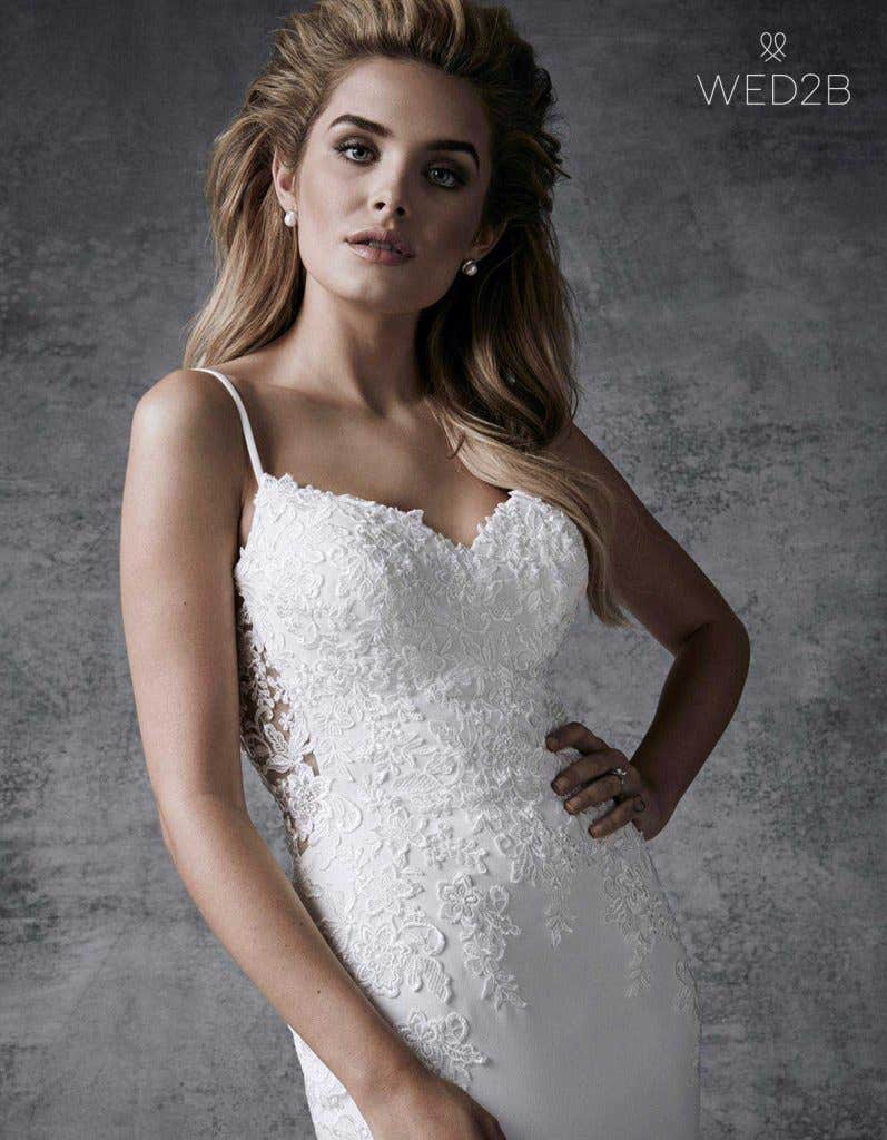 Close-up view of Hayden by the Signature Collection, a sexy lace wedding dress