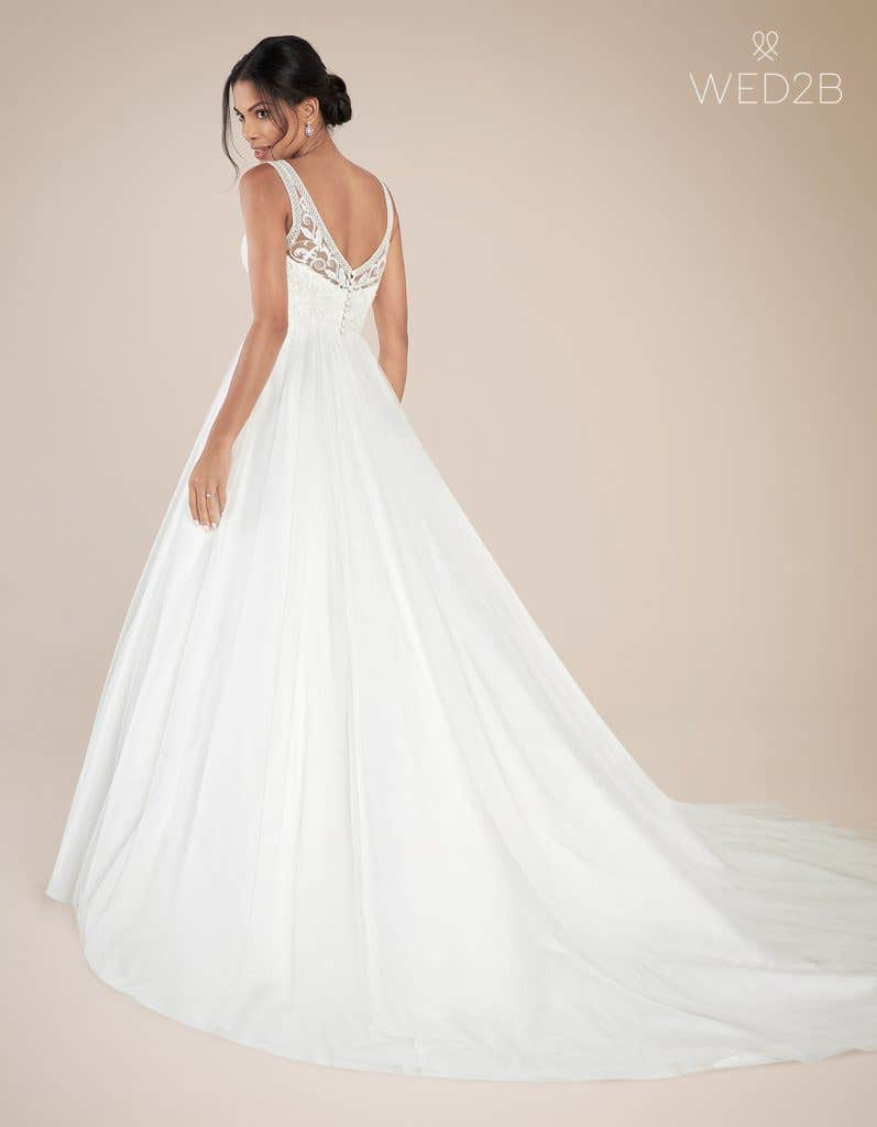 Back view of Adelpha by Anna Sorrano, one of our exquisite wedding dresses, with accessories
