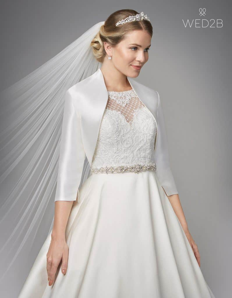 Close-up view of Gianna by Anna Sorrano, a lace wedding dress UK, with accessories