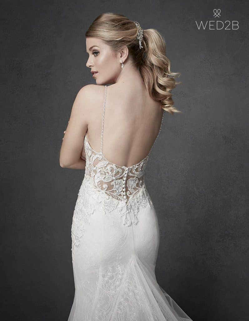 Close-up back view of Kennedy by The Signature Collection, one of our exquisite wedding dresses