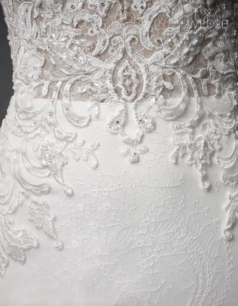 Detailed view of Kennedy by The Signature Collection, one of our exquisite wedding dresses
