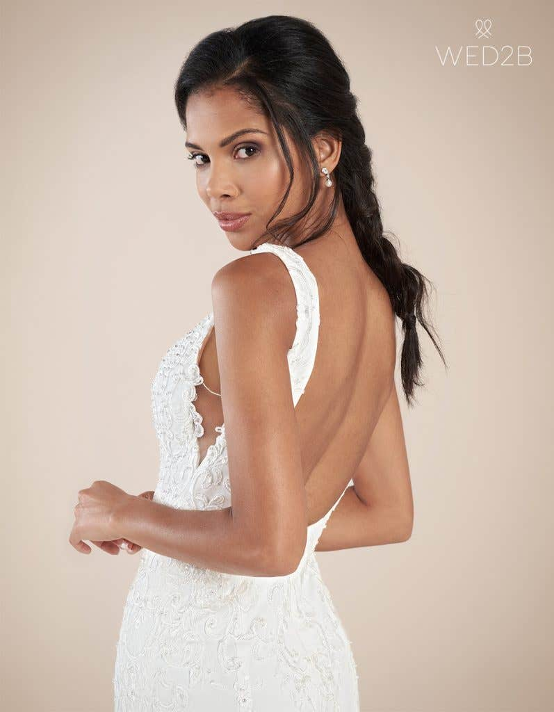 Close-up back view of Odyssey by the Signature Collection, a sexy lace wedding dress