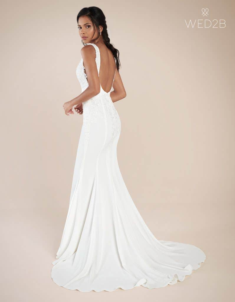 Back view of Odyssey by the Signature Collection, a sexy lace wedding dress