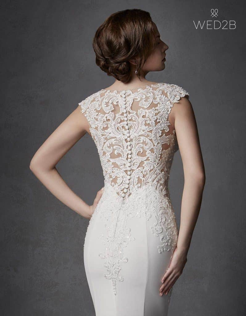 Close-up back view of Phoenix by the Signature Collection, a sexy lace wedding dress