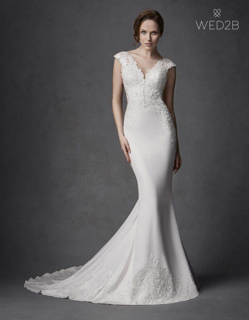 Front view of Phoenix by the Signature Collection, a sexy lace wedding dress