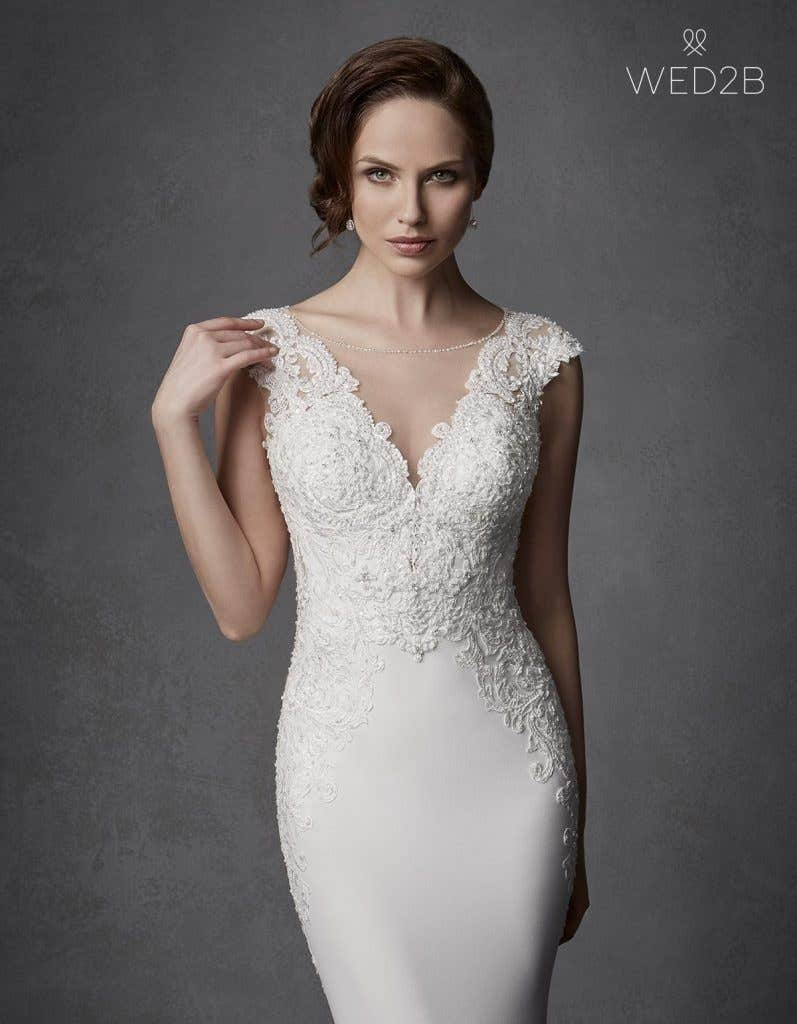Close-up view of Phoenix by the Signature Collection, a sexy lace wedding dress