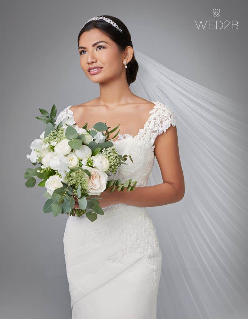Front view of luxury wedding dress Adina by Anna Sorrano with bouquet