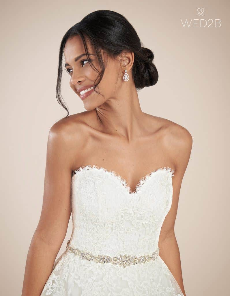 Close-up front view of luxury wedding dress Georgette by Anna Sorrano with accessories