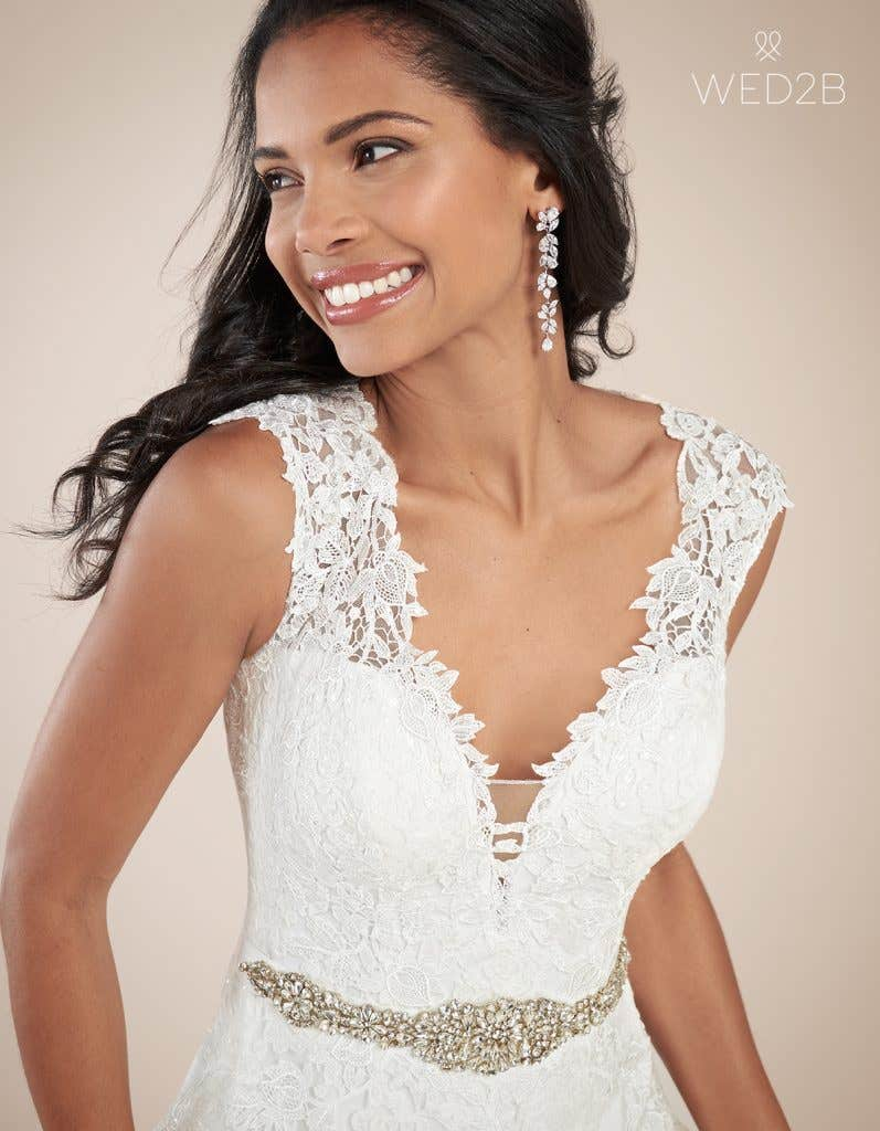 Close-up front view of luxury wedding dress Jamie by Viva Bride with accessories
