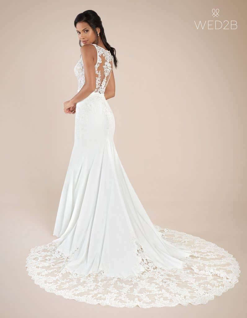Back view of fashion wedding dress Leon by The Signature Collection